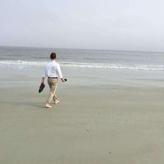 Greg walking on the beach in Tybee Island, GA