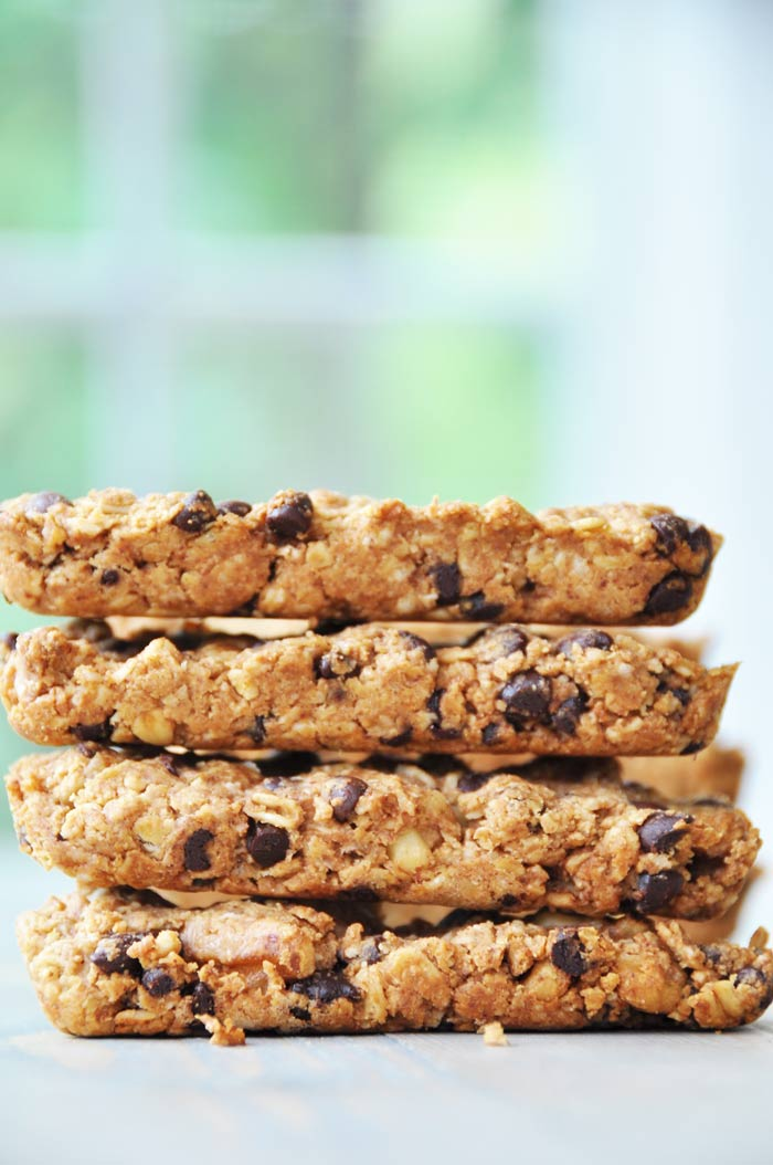 Granola bars stacked on a white surface