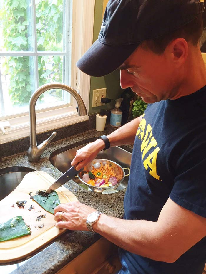 Scraping-the-skin-off-of-a-roasted-chili-pepper