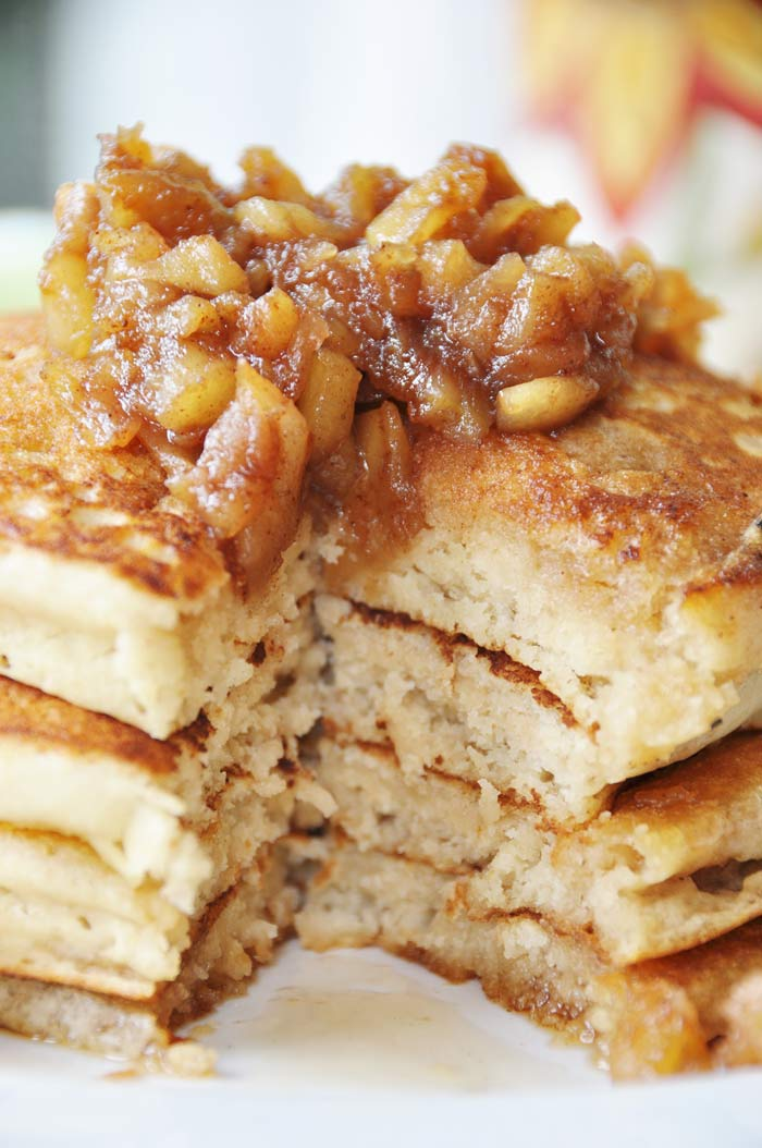 A close up shot of the inside of a stack of Old Fashioned Fluffy Vegan Pancakes with Apple Spice Compote on top.