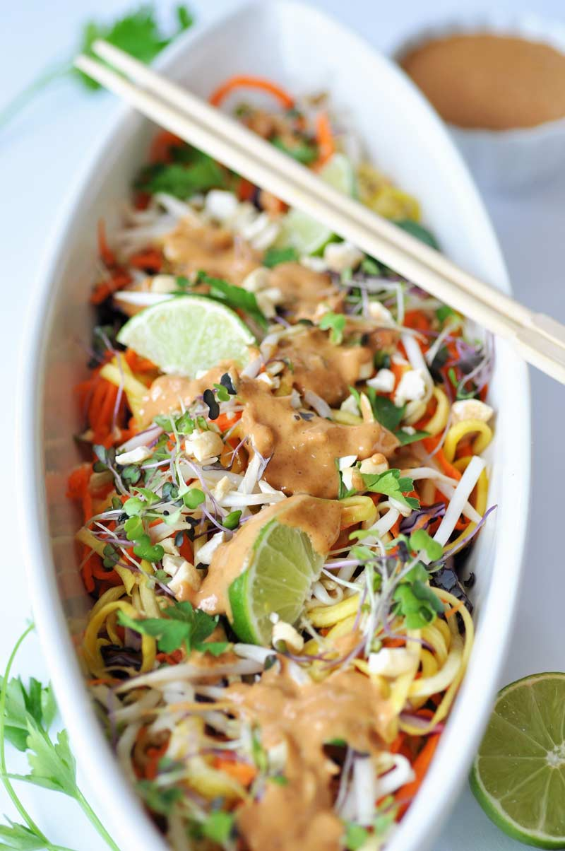 Raw Super Sprouts Pad Thai with a Spicy Peanut Sauce! This is the most delicious raw recipe I've had yet. Yellow squash, carrots, red cabbage, sprouts, and a creamy peanut sauce. www.veganosity.com
