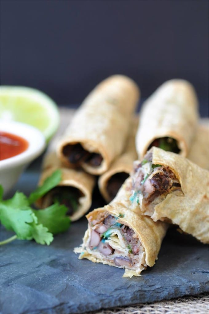 Homemade Black Bean & Spinach Taquitos! This taquito recipe is so crispy on the outside and savory and chewy on the inside. The perfect appetizer or make it part of a meal.