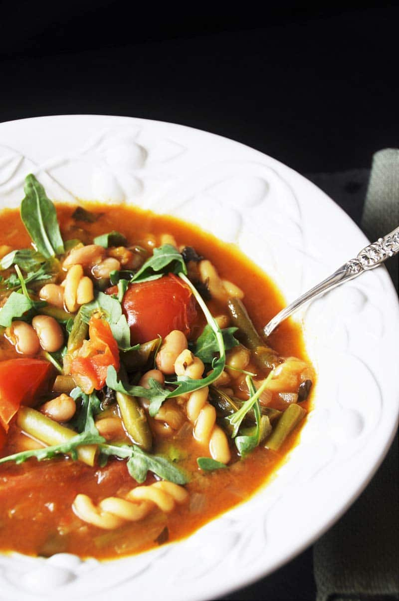 Homemade Minestrone Soup with Arugula! This minestrone soup recipe is so easy to make and so delicious. The peppery arugula adds a fresh and bold statement to an otherwise mild dish. www.veganosity.com