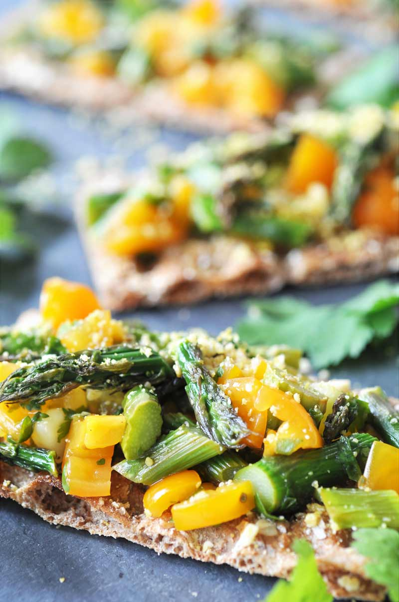 Asparagus Bruschetta with Lemon Cilantro Vinaigrette! Only 6 ingredients in this bright, beautiful, and delicious recipe. Perfect for your next get together or for a light meal.