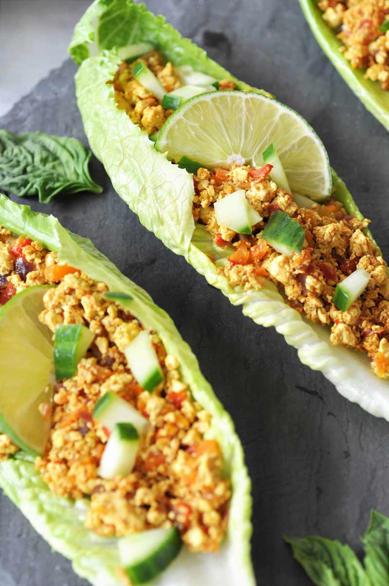 Spicy Sofritas Tofu Lettuce Wraps! This spicy tofu lettuce wrap recipe is perfect for a busy weeknight. Filled with protein, veggies, and lots of flavor. www.veganosity.com