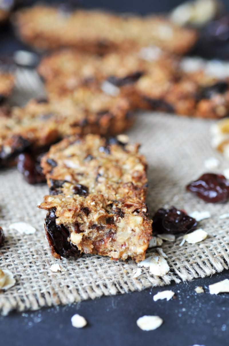 Chewy Cherry-Walnut Oatmeal Energy Bars! This granola bar recipe is filled with tart cherries, walnuts, and oats. Perfect for a post-workout snack or a quick pick me up. www.veganosity.com