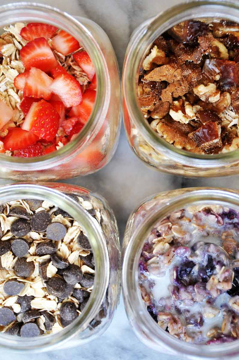 4 mason jars filled with different flavors of instant oats.