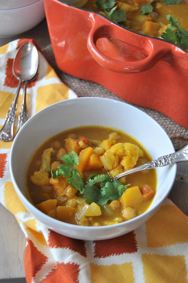Yellow curry, pumpkin, butternut squash, and chickpeas are what makes this stew hearty, satisfying, and healthy. The aromatic spices make it incredible. www.veganosity.com