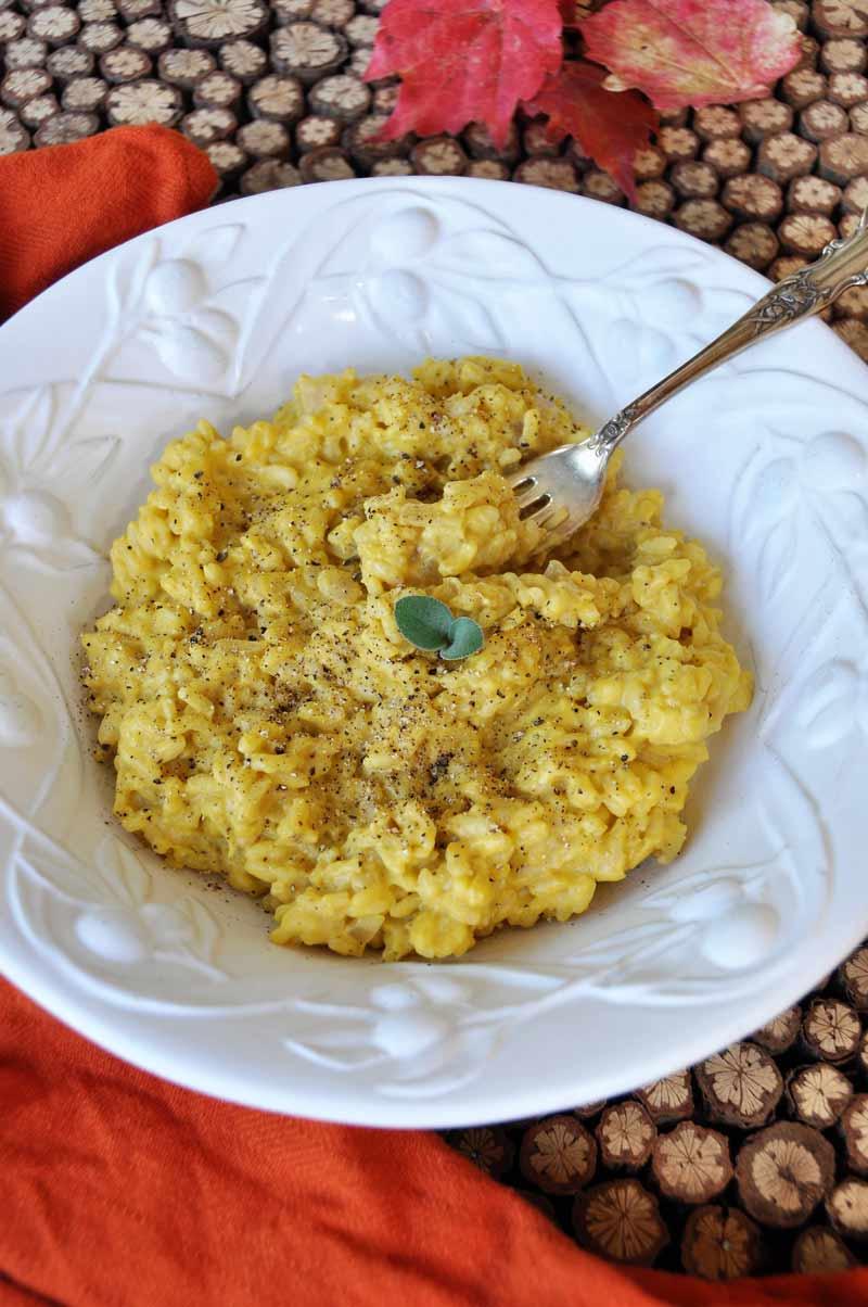 Creamy pumpkin sage cream sauce in chewy risotto. The ultimate comfort food recipe! www.veganosity.com