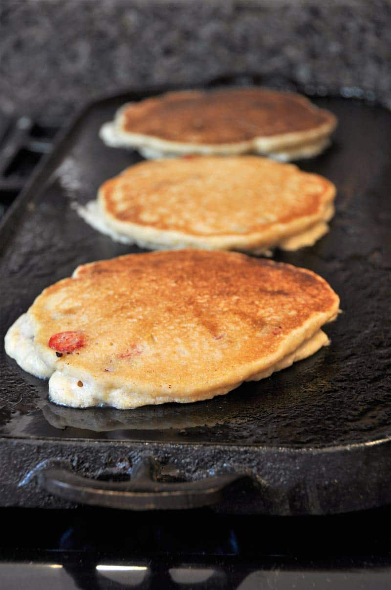 Vegan Cranberry Orange Pancakes for breakfast! Dairy and egg-free recipe, fluffy, and delicious! www.veganosity.com