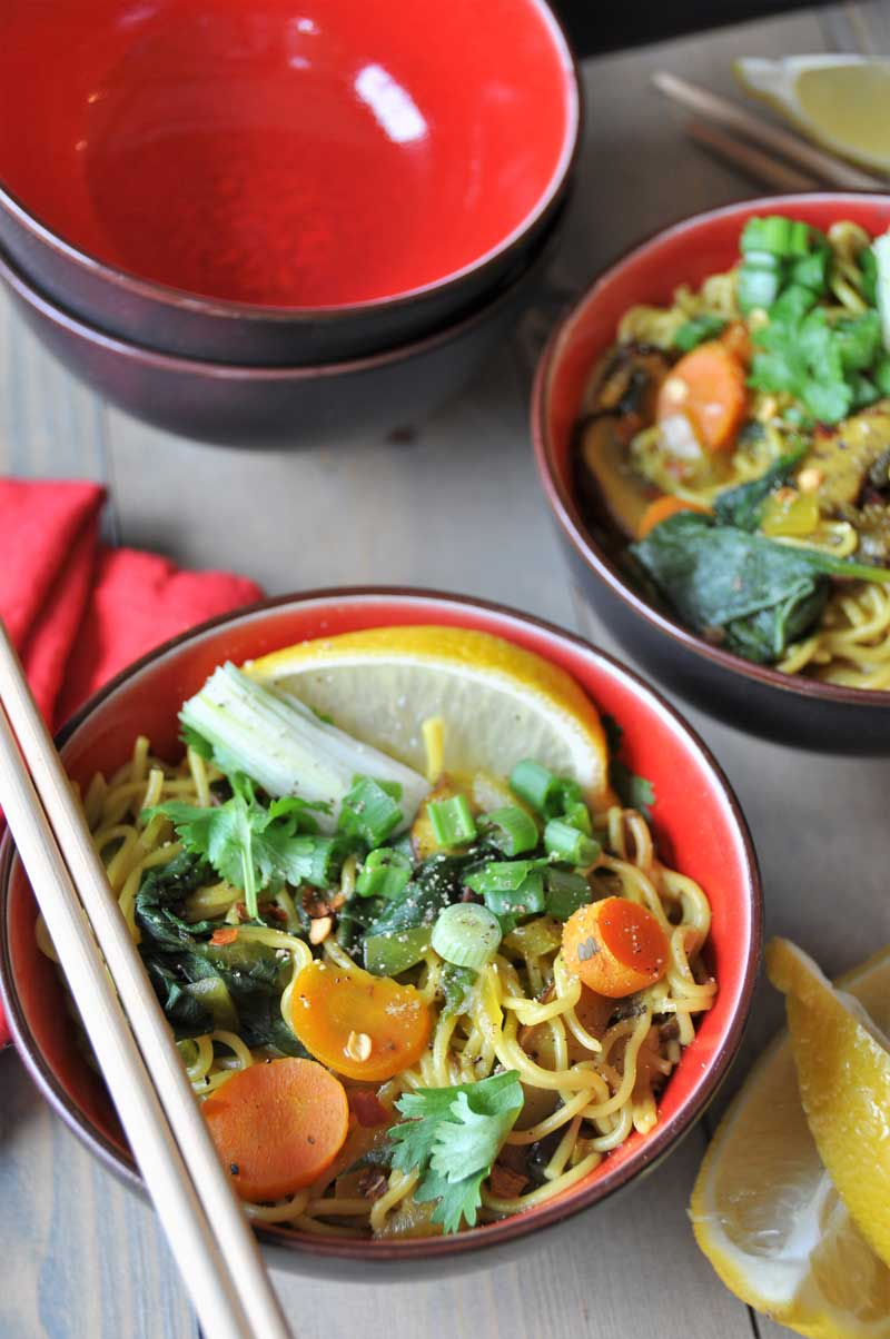 Vegan & Gluten-Free ramen noodle soup filled with delicious flavors and veggies! So healthy with anti-inflammatory turmeric and ginger! www.veganosity.com