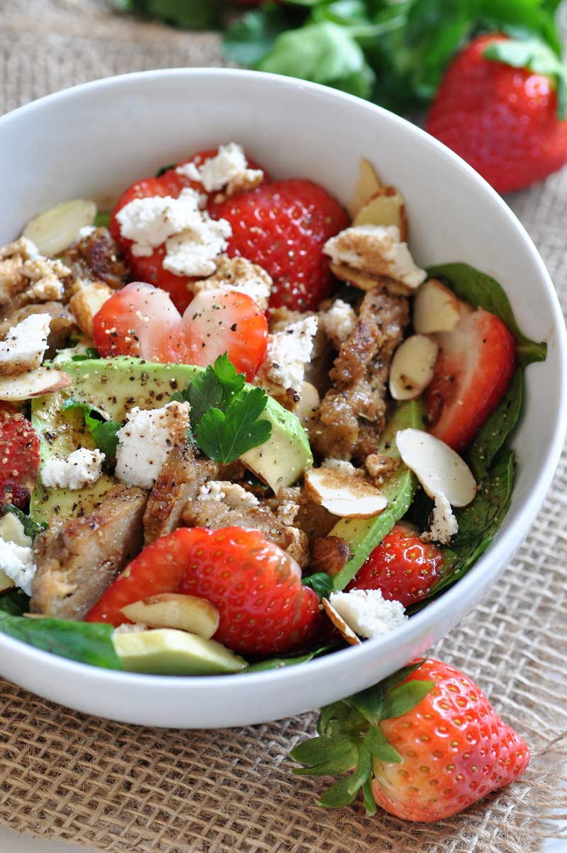 Fresh strawberries, avocado, spinach, and seitan chicken salad! Healthy, vegan, and dairy-free, perfect for a quick lunch.