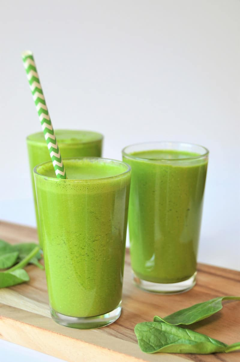5 ingredient homemade green juice with spinach, apple, lemon, and turmeric. A healthy and tasty way to drink your veggies.