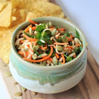 Jicama, carrots, Pablano pepper, in a refreshing lime dressing, topped with roasted pepitas! The perfect slaw salsa appetizer!