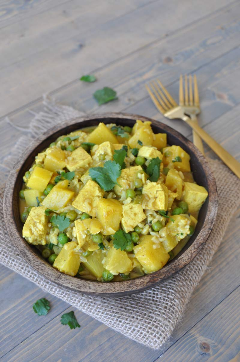 A simple and easy curry dish with tofu, pineapple, peas, and cilantro. The perfect healthy and quick dinner recipe.