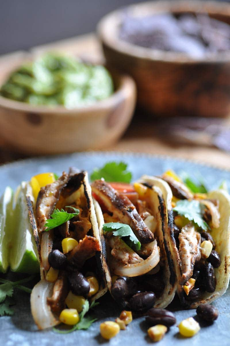 Spicy black beans, corn, and shitake mushroom tacos! The best appetizer or quick meal.