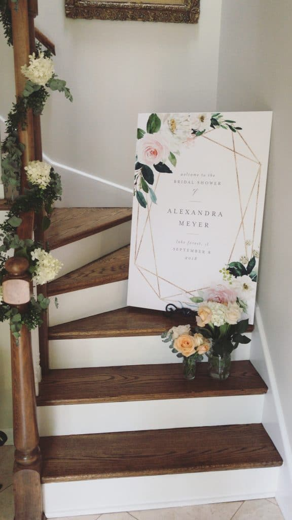 Bridal Shower Sign with fresh flowers and garland on wood stairs