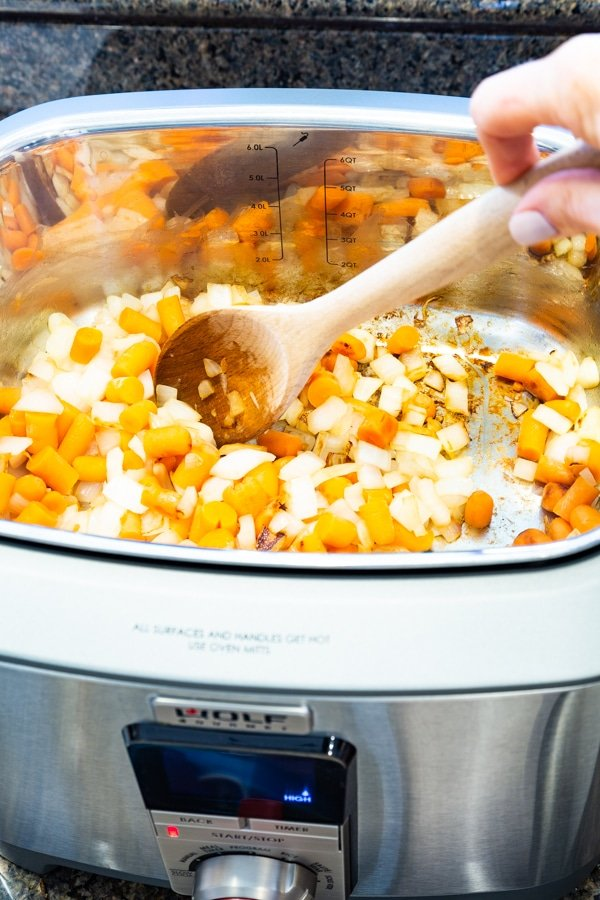 Sauteing carrots and onions in a Wolf Gourmet Multi-Function Cooker