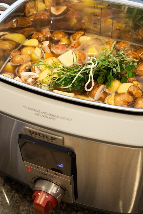 Vegan beef stew simmering in a Wolf Gourmet Multi-Function Cooker