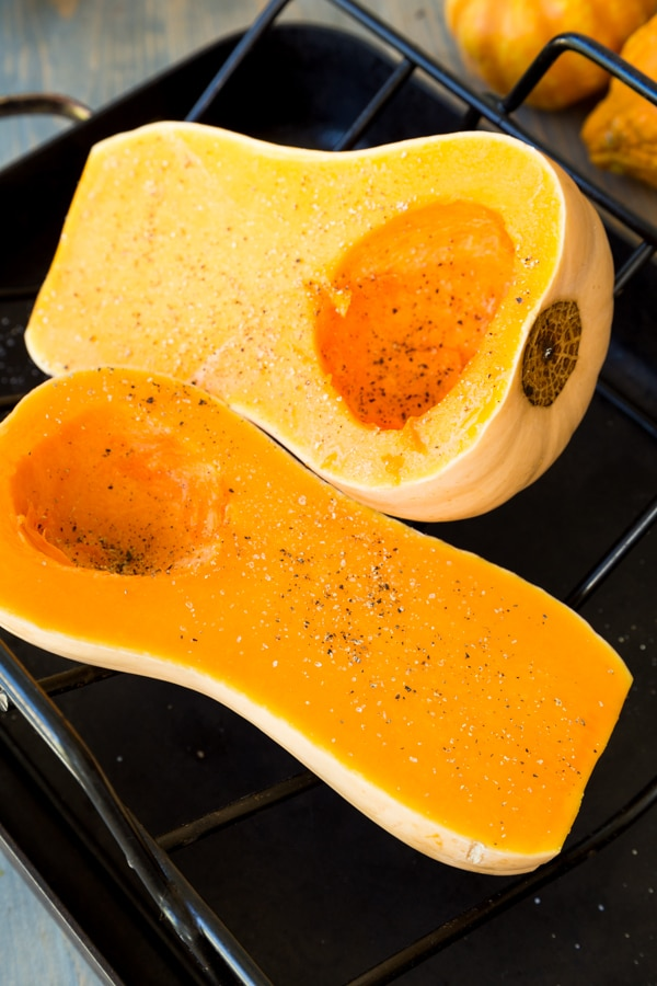 Process shot of butternut squash cut in half with seeds scooped out