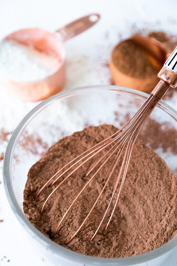 Whisking the dry ingredients of chocolate cake together with a whisk