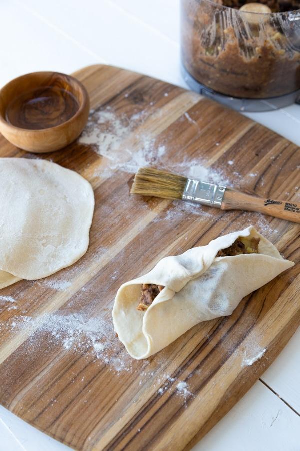 Folding the dough for empanadas