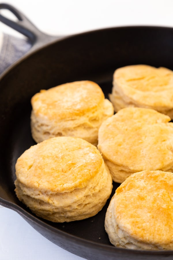 A cast-iron skillet with homemade biscuits