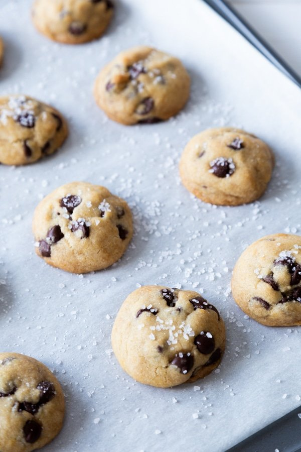 Chocolate chip cookies on a baking sheet with parchment paper