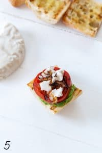 avocado spread with grilled tomato, vegan mozzarella, and fried shallots