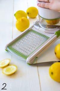 Arugula and fennel salad with fried lemons process shot of a mandoline slicing lemons.