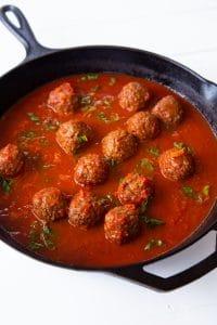 Veganosity's favorite brand of Meatballs in red sauce in an iron skillet