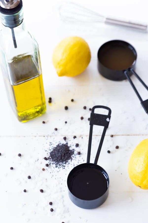 A lemon, olive oil, apple cider vinegar, and spices for salad dressing