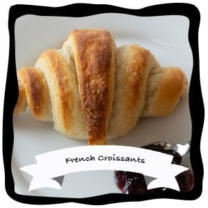 vegan recipe videos of french croissants with blueberry jam on a white plate