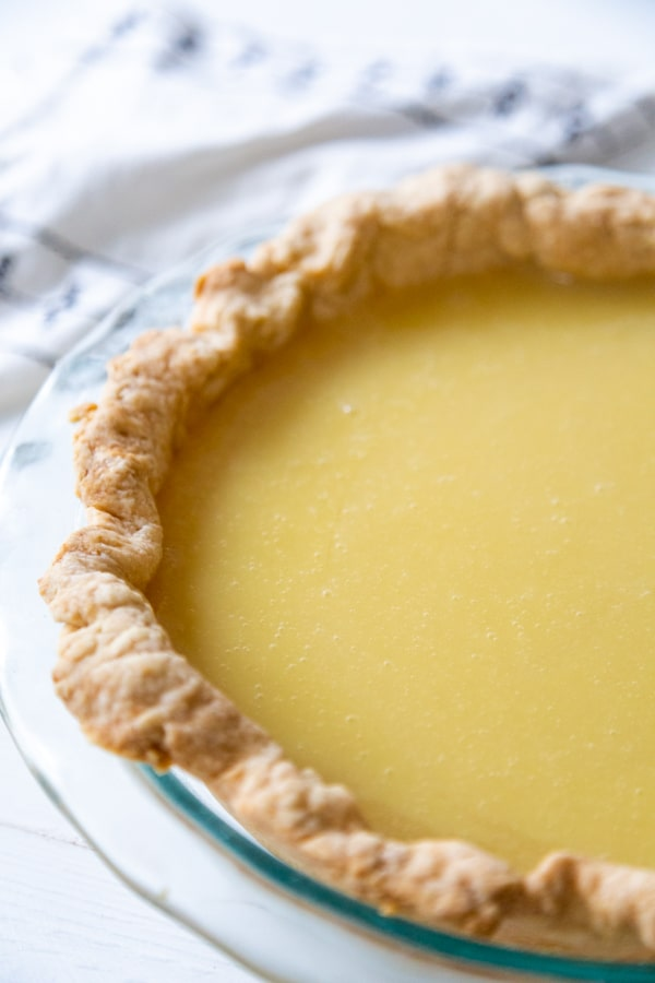 A pie crust with lemon pie filling.