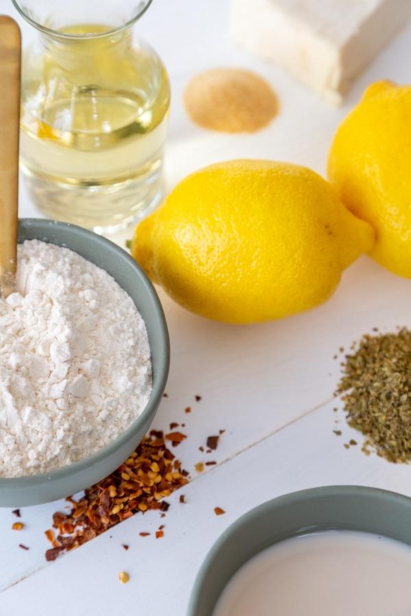 Ingredients for a roux, lemon, flour, butter, wine, spices.