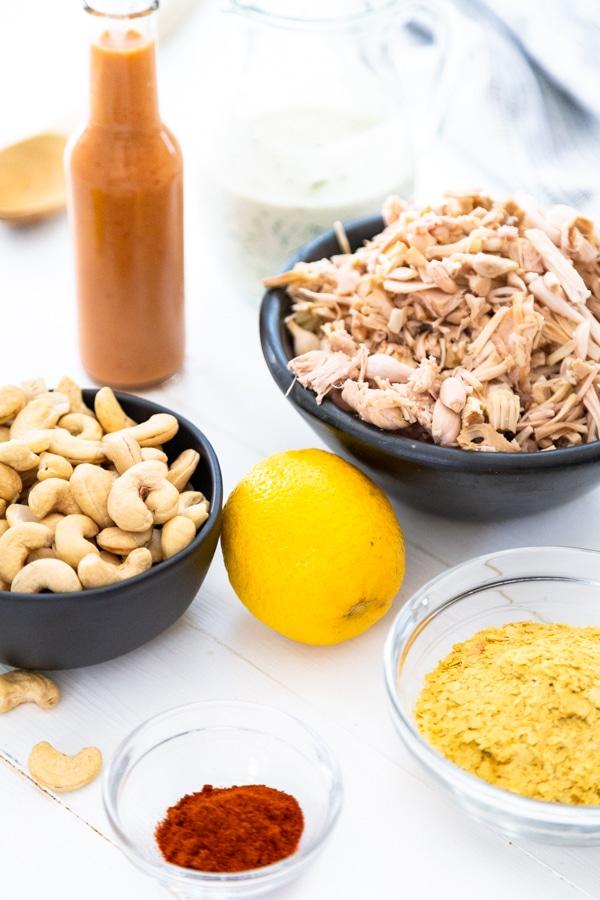 Bowls of ingredients for vegan buffalo chicken dip.