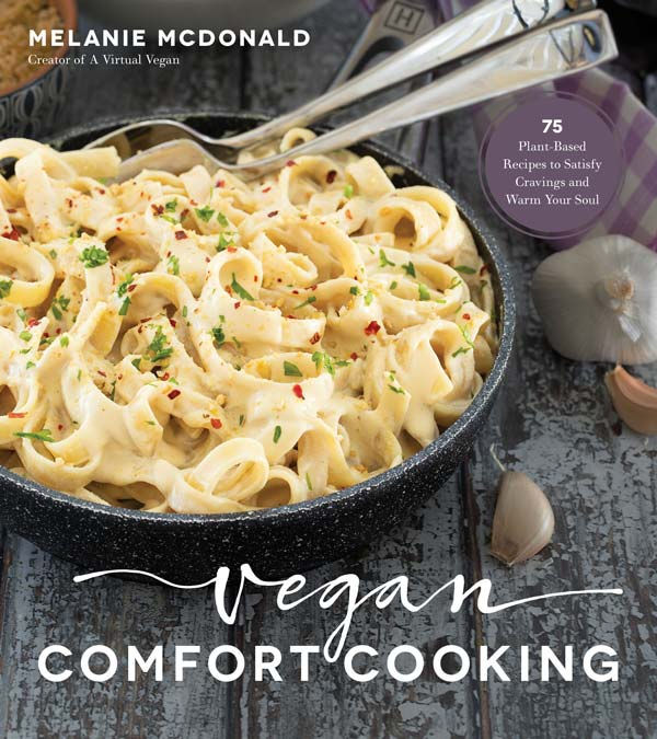The cover of Vegan Comfort Cooking with a picture of a bowl of Alfredo with pasta.