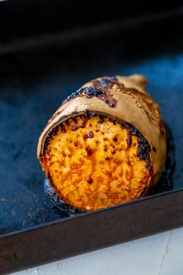 A roasted sweet potato with caramelized edges.