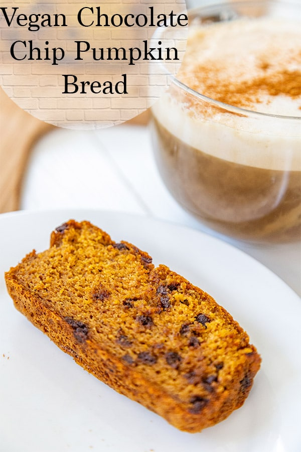 Vegan Chocolate Chip Pumpkin bread on a white plate with a large vegan cappucino