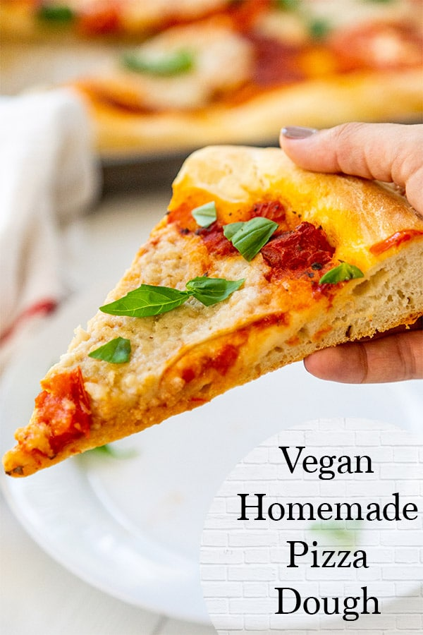 vegan homemade pizza dough covered in vegan cheese, basil, and tomato sauce
