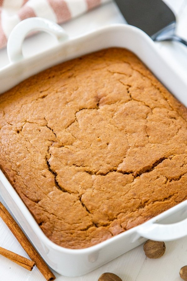 Spice cake in a square white cake pan.
