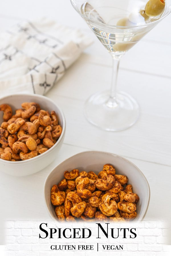 A Pinterest pin for spiced nuts with a picture of 2 bowls of the nuts.
