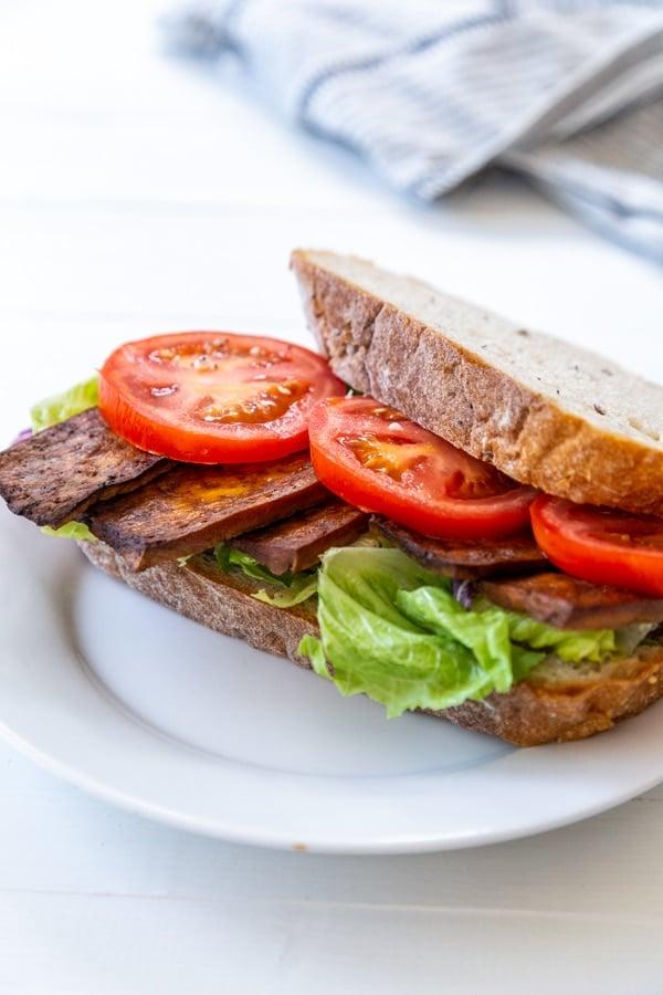 A BLT sandwich on a white plate.