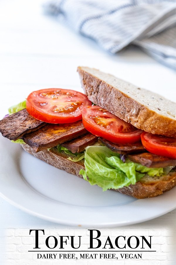 A Pinterest pin for tofu bacon with a picture of a vegan BLT sandwich on a white plate.