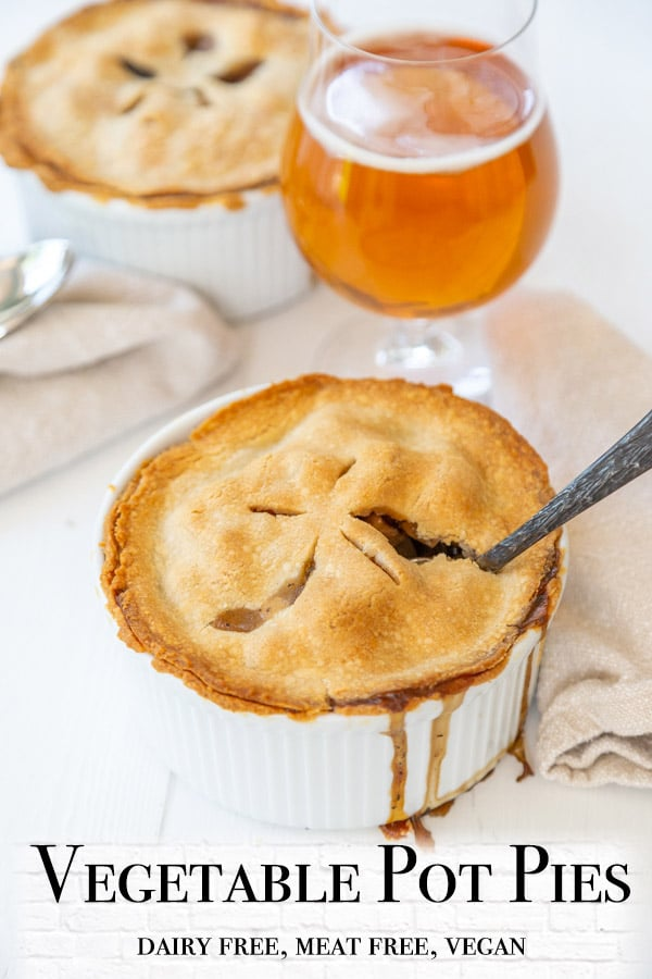 A Pinterest pin for vegetable pot pies with 2 pot pies and a beer in the picture.