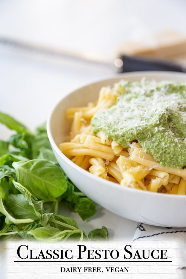 A Pinterest pin for vegan pesto with a picture of pasta and pesto.