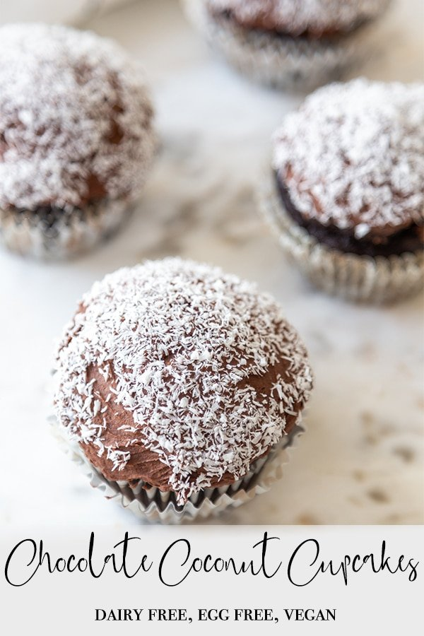 A Pinterest pin for vegan chocolate coconut cupcakes with a picture of the cupcakes on a marble board.