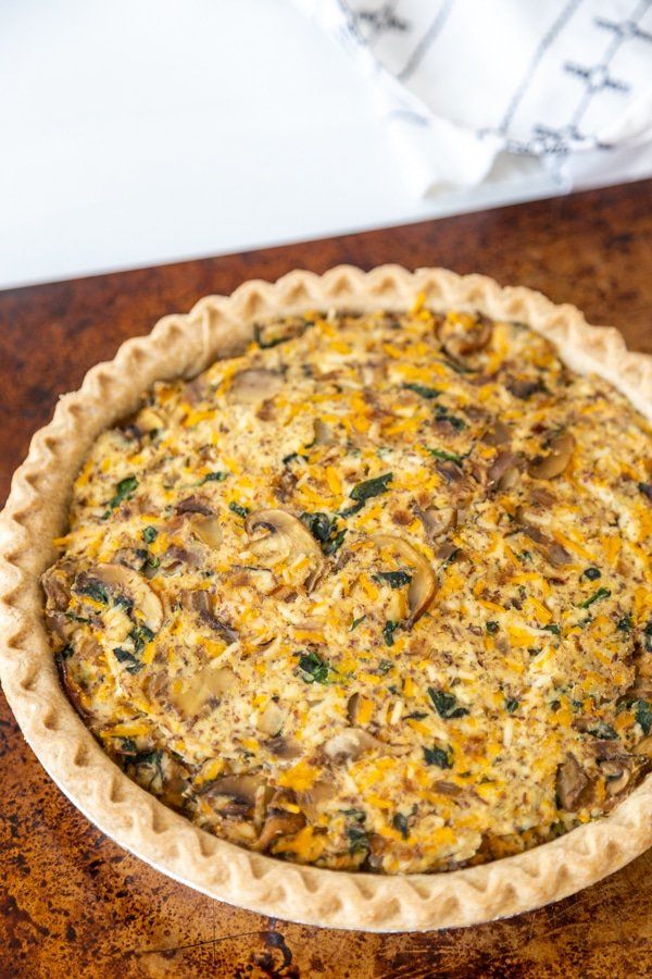 A vegetable quiche on a baking sheet.