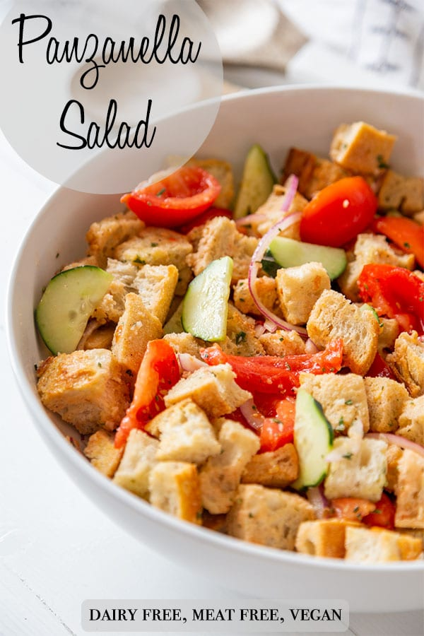 A Pinterest pin for Panzanella salad with a white bowl of the salad.