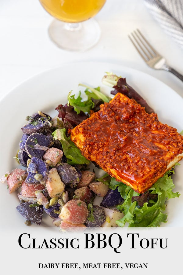 A Pinterest pin for Classic BBQ Tofu with a picture of the tofu and potato salad on a white plate.